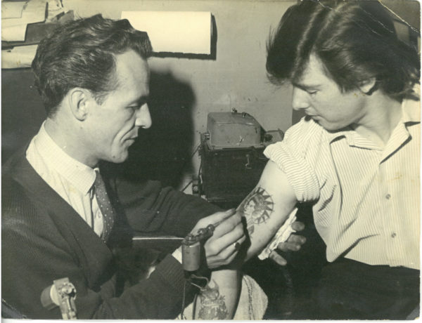 Charlie Bell tattooing