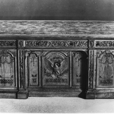 Black and white photograph of the Resolute Desk