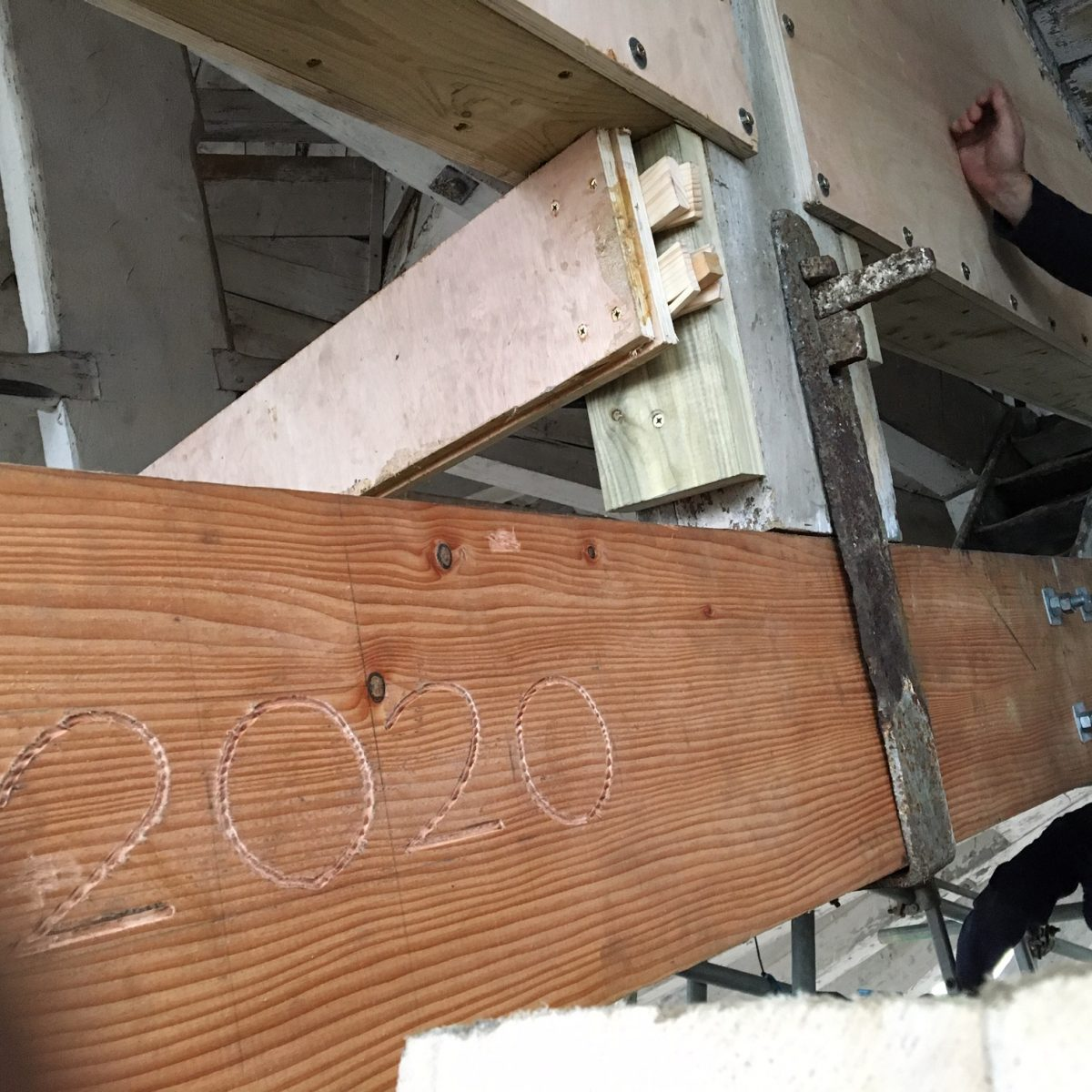 Carving of the data 2020 in new wood as part of 3 Slip repair at The Historic Dockyard Chatham