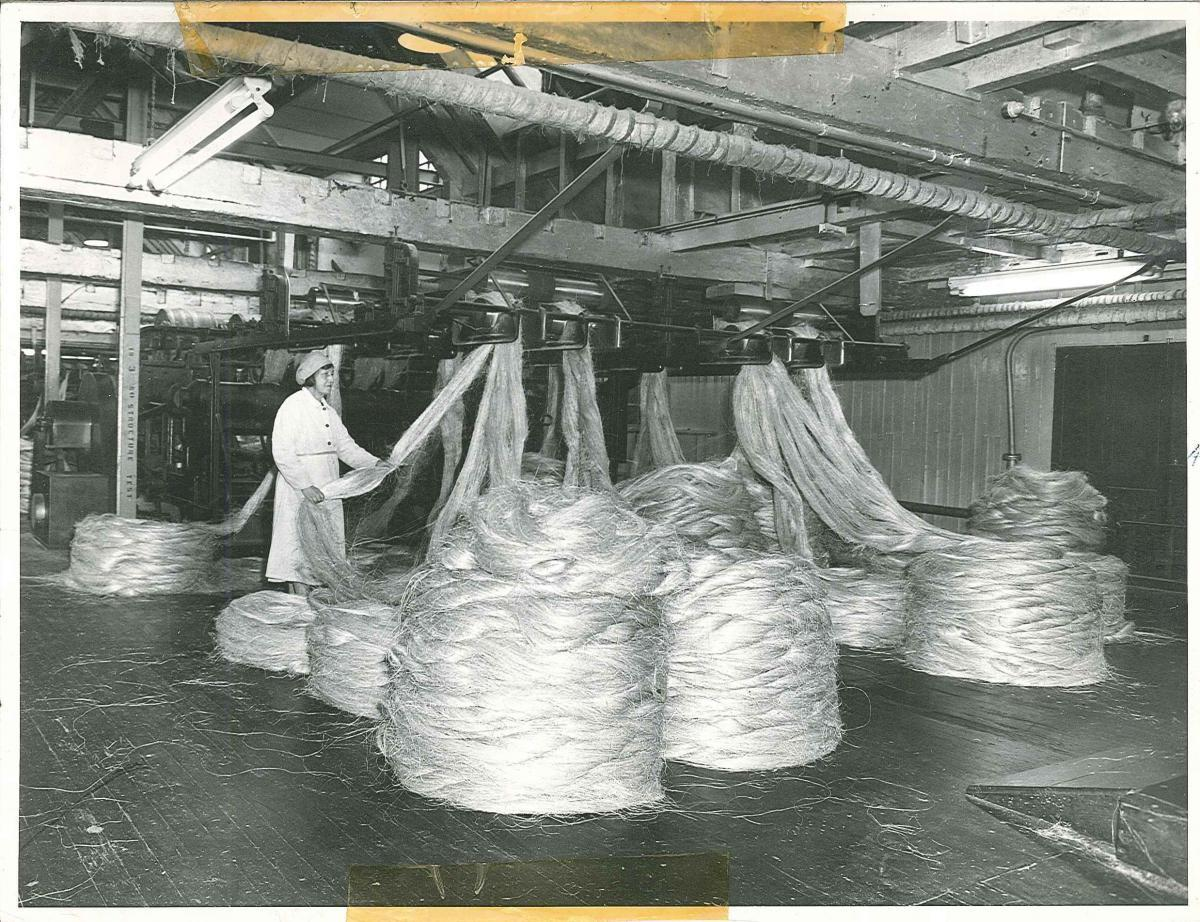 Ropery female staff member and rope bales.